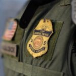 Agent Manny Villalobos suits up for his night patrol along the international border between Mexico and the United States near San Diego